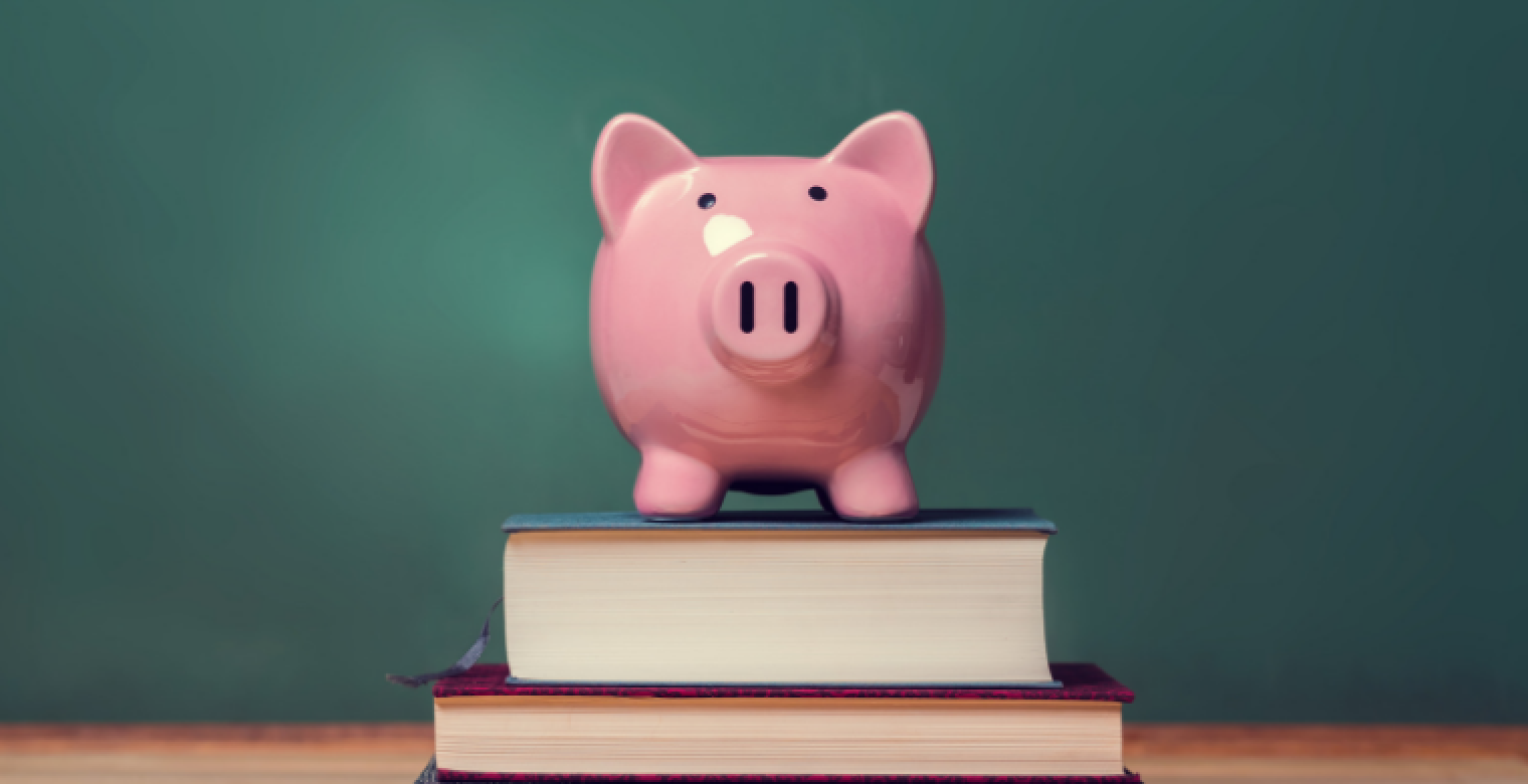 Finanical Aid Books and Piggy Bank