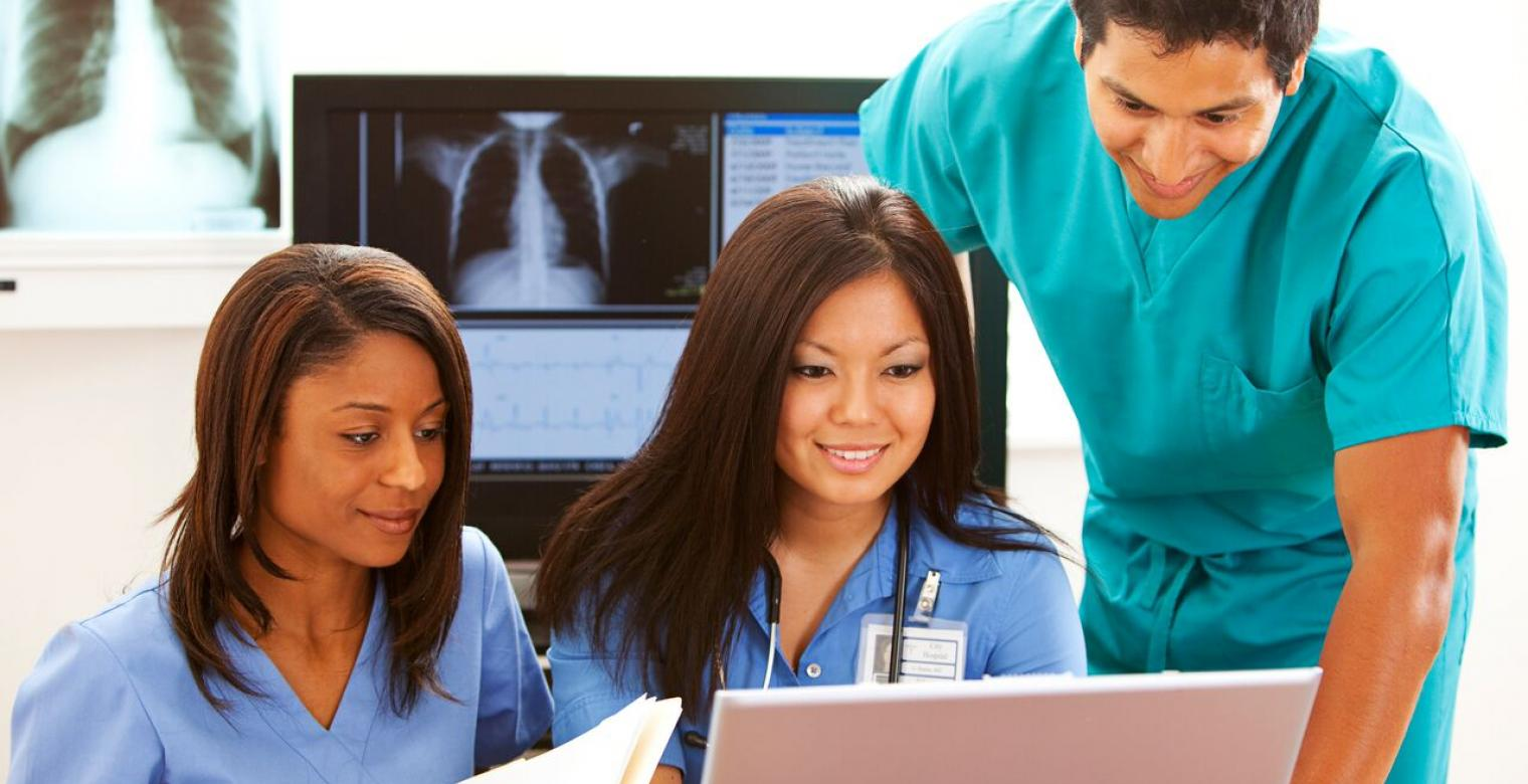 Medical professionals working at the computer